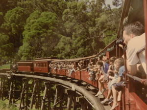 The century old Puffing Billy Railway making it way across the timber trestle
